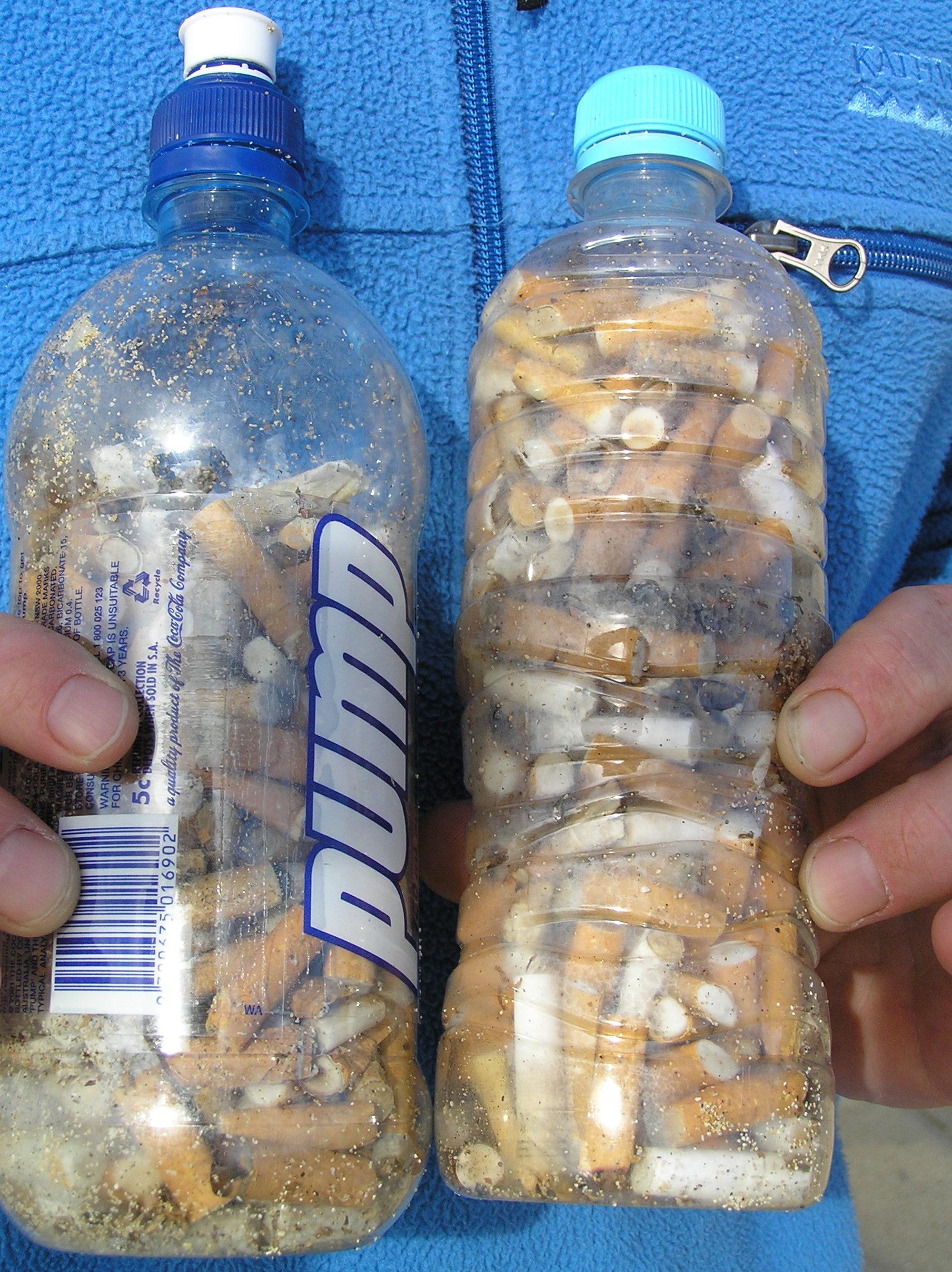 Image result for cigarette butts in water bottles