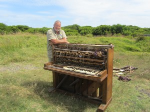 Great Ocean Road Coast Committee Outdoor Works Supervisor, Phil Brown with a piano that was illegally dumped near the Point Impossible nudist beach in Torquay.