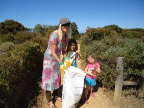 Kit-e Kline and children Makeisha, 6, and Jamaiyah, 3, help clean up the rubbish around Bird Rock car park during Clean Up Australia Day 2013 held in March.