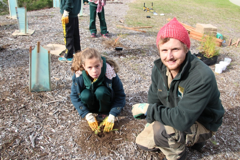 GORCC conservation worker Evan Francis with Torquay College student Indiana Colledge, helping to plant a Coastal Moonah Woodland as part of conservation activities organised by the Marine and Freshwater Discovery Centre.