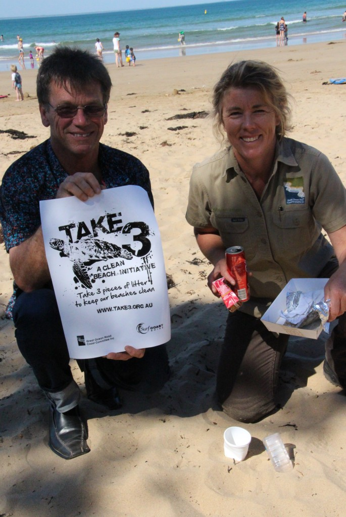 Surfcoast Shire's Cr David Bell together with GORCC's Georgie Beale encouraging beachgoers to take 3 pieces of rubbish when they leave the coast this summer.