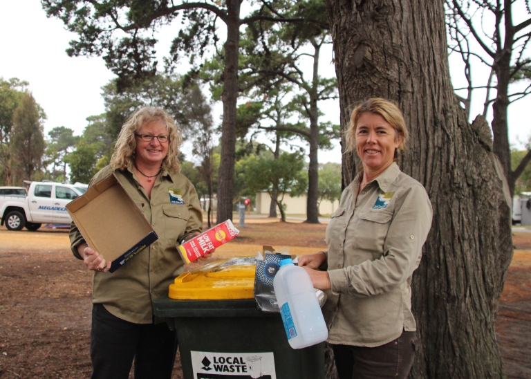 Education and Activities Leader Hillary Bouma (left) gets her hands dirty with Conservation Officer Georgie Beale