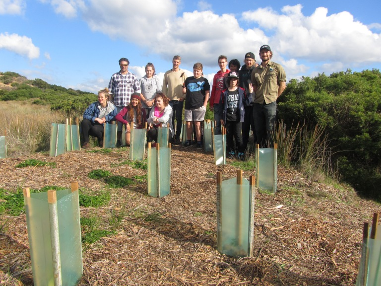 Students admire the handy work of the previous Northern Bay College group with GORCC Activity Education Leader Peter Crowcroft (far right).