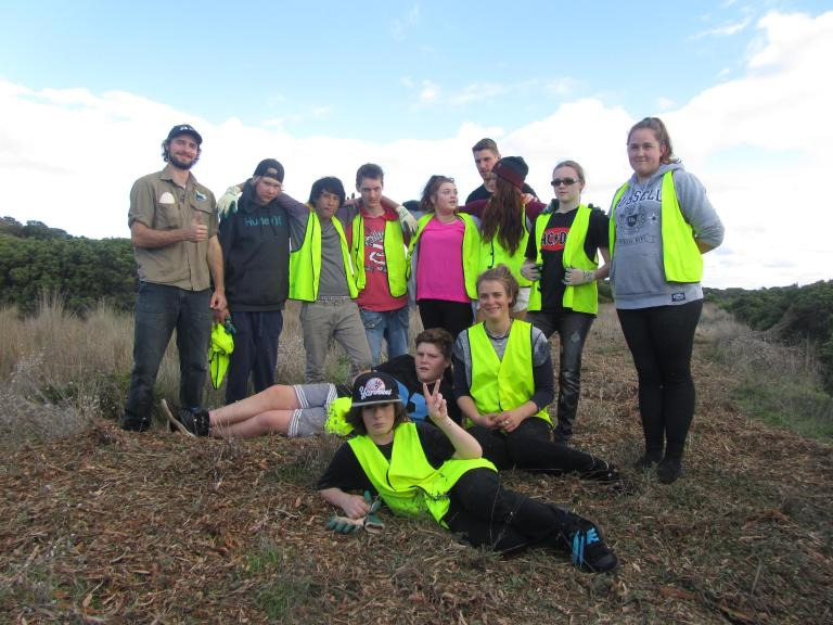 GORCC Activity Education Leader Peter Crowcroft with satisfied Northern Bay College students after laying 100m of mulch along coastal soil.