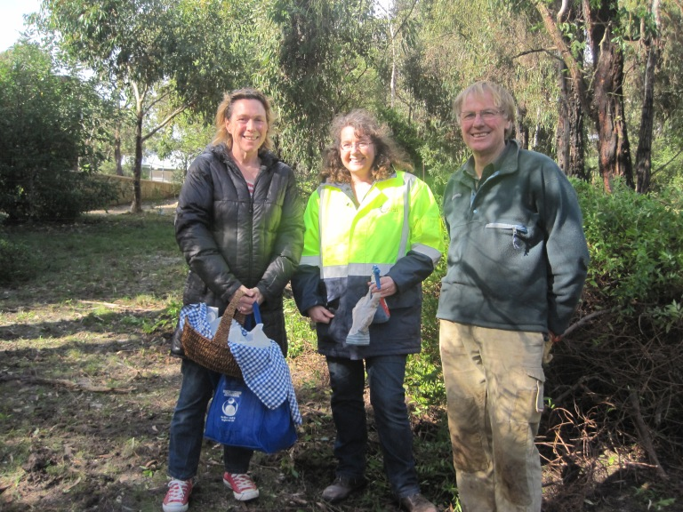 Surf Coast Environmental Officer Leanne Rolfe (centre) and ANGAIR Committee Member Roger Ganley (right) with grateful landowner who made chocolate snowballs for hardworking volunteers.