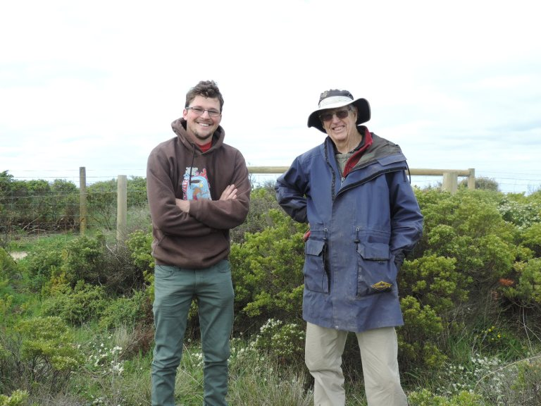Jan Juc Coast Volunteers Tom Elford (left) and Ian Edwards share their conservation beliefs at the orchid-recovery day.