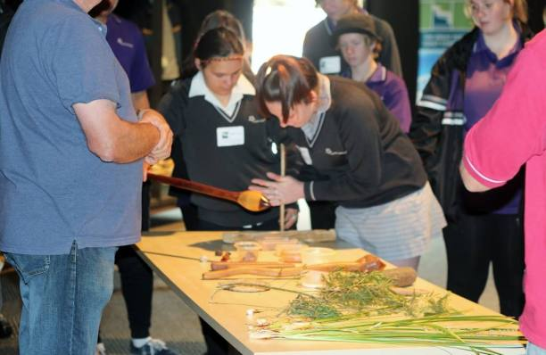 Students attending the forum try their hand at making fire the traditional way with Elder Bryon Powell of the Wathaurung Aboriginal Corporation. Photo: GORCC