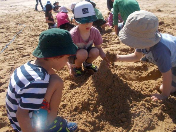 Jan Juc Preschool kids building sandcastles with items collected in the treasure hunt.