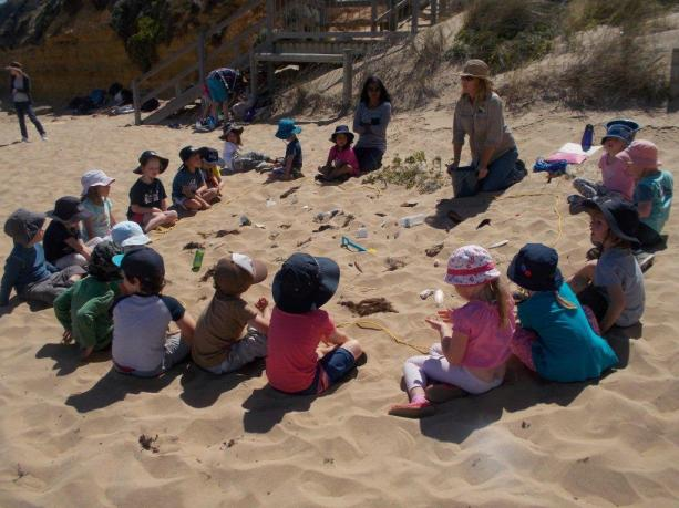 GORCC Conservation Supervisor Georgie Beale teaches Jan Juc Preschool about what belongs at the beach.