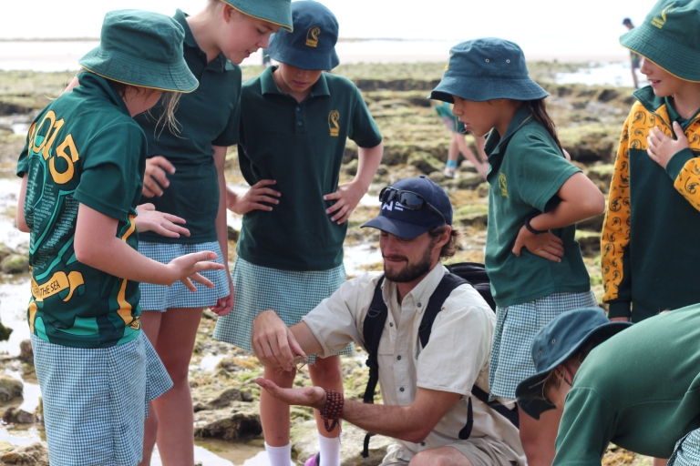 GORCC Education Leader Pete Crowcroft holds a crab for the students to get a better look