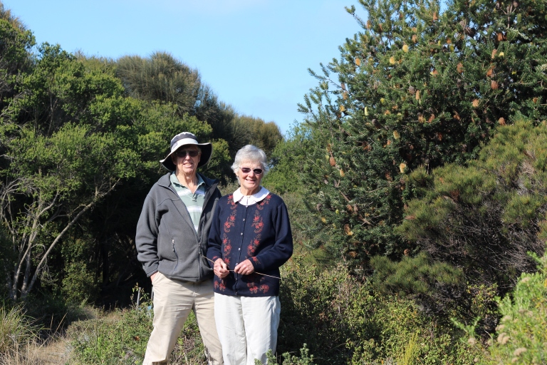 Ian and Roma Edwards stand in their Indigenous garden.