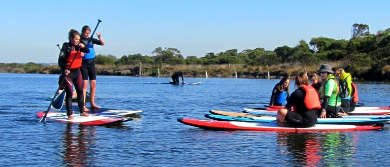 Northern Bay College students experience environmental education from a different perspective on stand-up paddle boards.
