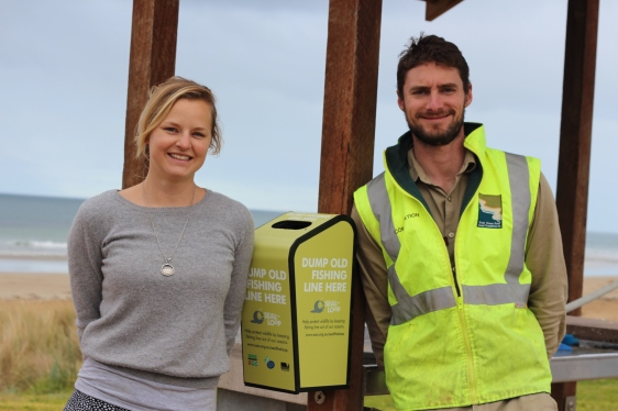 GORCC Environmental Projects Coordinator Alex MacDonald and GORCC Education Coordinator Pete Crowcroft with a Seal the Loop bin in Torquay.