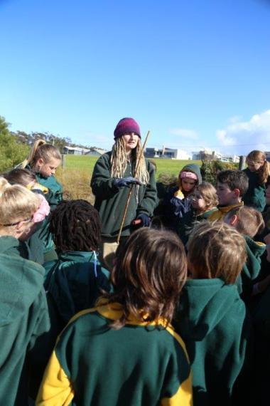 GORCC Conservation Worker Rachael Beecham explains how to plant the Indigenous species.