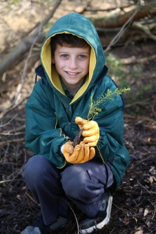 A student shows the type of indigenous plants that are being planted.