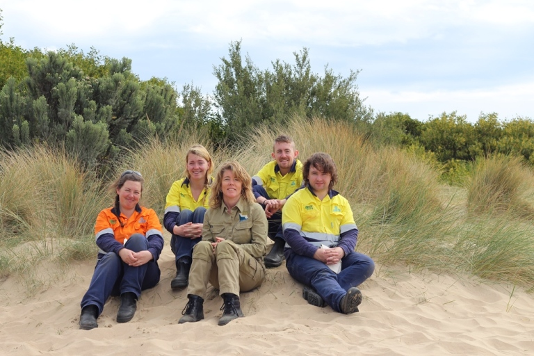 Conservation Volunteers Australia Green Army Supervisor Jane , Green Army participants Caitlin Ball, GORCC Conservation Supervisor Georgie Beale and Green Army participants take a break from removing litter along the foreshore.