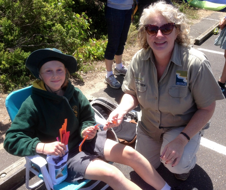 GORCC Education Activity Leader, Hilary Bouma, collecting a prize from a student