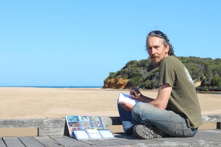 Artist Mark Trinham working on the wildlife cards
