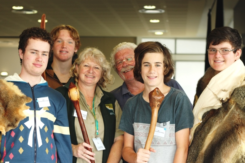 Students showing off some aboriginal items. From left: Geelong Lutheran College students Jera Norton, Cameron Wilkinson, Taj Dillon, and Benjamin Lunt with Education Activity Leader Hilary Bouma and Wathaurung Aboriginal Elder Byron Powell.