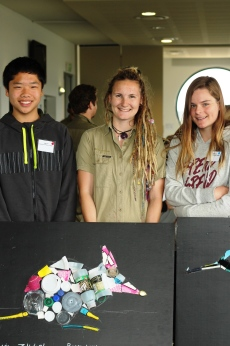 Geelong Lutheran College students Timothy Newton and Isabella B showing off their artwork with Rachael Beecham