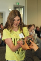Geelong Lutheran College student Jessica holding a Blue Tongue Lizard