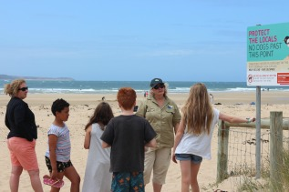 GORCC Education Activity Leader Hilary Bouma explains why it is important to always check signs at the beach.