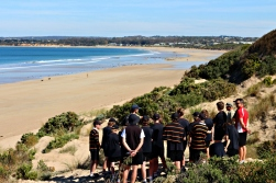 Students attentively listen to GORCC Education Coordinator Pete Crowcroft talk about coastal conservation.