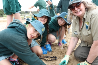 Torquay College students with Hilary Bouma collect microplastics from Fishermans Beach.