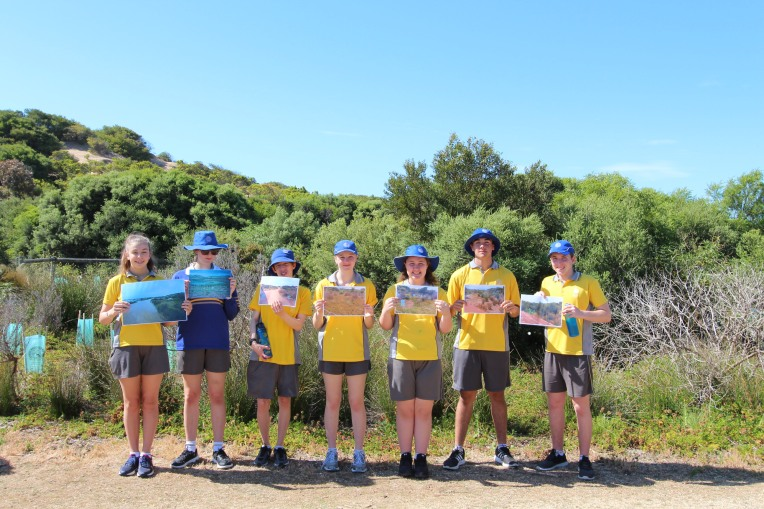 Students show before and after photos documenting the progress at Whites Gap, Torquay.