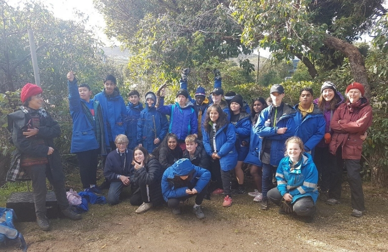 Mackillop College yr 8 students - standing in front of weeds removed alongside Friends of Eastern Otways and Parks Vic staff
